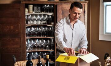 Man Opening Holiday Wine Box